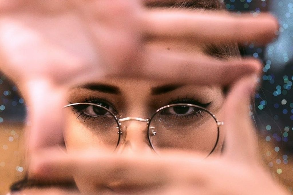Woman Wearing Round Framed Eyeglasses